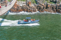 Speedboat entering the Storms River gorge Stock Photos