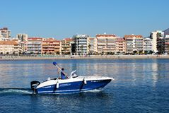 Speedboat with Fuengirola beach to rear. Royalty Free Stock Images