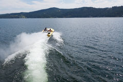 Speedboat Heading out into the Lake Stock Photography