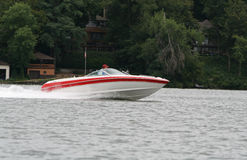 Speedboat on lake. Side view of speedboat on lake with shoreline in background Stock Photography