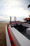 Speedboat on morning beach. An empty red and white eyecatching speed boat on the sandy beach of a tropical resort.  Taken early morning in clear weather on Royalty Free Stock Image