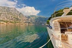 Speedboat near the pier. On mountains background. Montenegro Stock Image