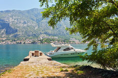 Speedboat near the pier. On mountains background. Montenegro Stock Photography