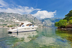 Speedboat near the pier. On mountains background. Montenegro Royalty Free Stock Image