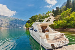 Speedboat near the pier. On mountains background. Montenegro Stock Images