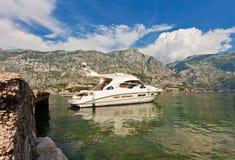 Speedboat near the pier. On mountains background. Montenegro Royalty Free Stock Photos