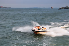 Speedboat and people Stock Photos