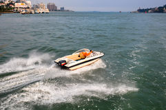 Speedboat and people Royalty Free Stock Image