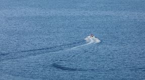 Speedboat pulling inflatable donuts boats Stock Photos