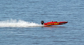 Speedboat racing. Photo of a red speedboat speeding along the kent coast of whitstable during october 2016 ideal for sports,racing,action etc Royalty Free Stock Images