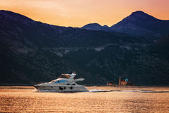 Speedboat in the sunset sea Royalty Free Stock Photos