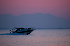 Speedboat at sunset Stock Images