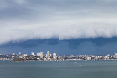 Speedboat in Sydney Harbour under Arcus Storm Cl Stock Photo
