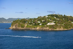 Speedboat and waterfront homes, St Lucia Royalty Free Stock Photography