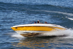 Speedboat in yellow & White. Speedboat on a small lake Royalty Free Stock Photos