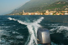 Action Speedboating on Lake Garda. Rear view from a speedboat on Lake Garda (Lago di Garda) in Italy. Motion, action and waves with the beautiful Lake Garda Stock Images