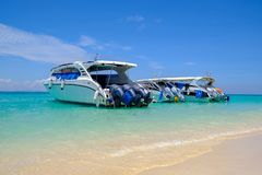 Speedboats at the beautiful beach of tropical island, in waiting for passengers royalty free stock images