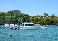 Speedboats at the Gili Meno island in Lombok, Indonesia.  Stock Photo