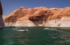 Speedboats on Lake Powell. A speedboat enjoys a summer day on Lake Powell at the Arizona and Utah Border Stock Image