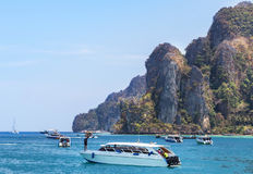 Speedboats and motorboats moored in andaman sea at Phi Phi Don island , Thailand Stock Photos