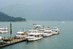 Speedboats at the pier in Sun Moon Lake, Taiwan. Speedboats dock at the pier in Sun Moon Lake, Taiwan Stock Image