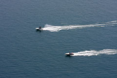 Speedboats racing. Two speedboats racing along the water Royalty Free Stock Image