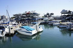 The SPEEDBOATS. Speed boats were docked by the owners at the New Port Beach in layers and on the water Stock Photos