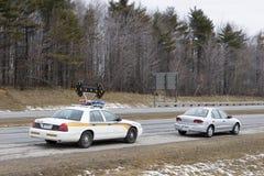Speeder zog vorbei durch Polizei Stockfotografie