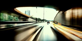 Speeding. A view from a vehicle as it speeds on the expressway out of a tunnel Stock Images