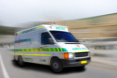 Speeding ambulance Stock Images