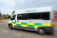 Speeding ambulance England Stock Images