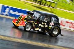 Speeding Americam Hot Rod dragster Royalty Free Stock Image