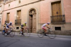 Speeding bicycle racers. In a city Royalty Free Stock Photos