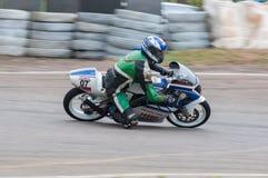 Speeding bike Stock Photography