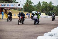 Speeding bikes Stock Photo