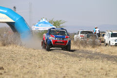 Speeding blue and red Toyota Nissan single cab rally car at star Royalty Free Stock Photos