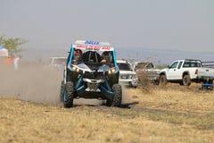 Speeding blue and white Maverick 1000T Turbo rally car front vie. Sun City, South Africa – OCTOBER 1, 2016: Front view of Speeding blue and white Maverick royalty free stock photos