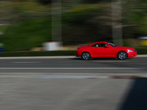 Speeding Blurred motion red car Royalty Free Stock Images
