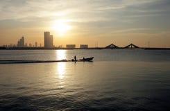 Speeding boat against Bahrain skyline during sunset Royalty Free Stock Photo