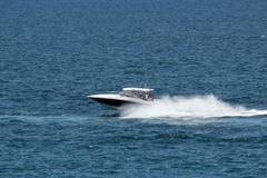 Speeding boat Stock Photos