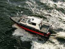 Speeding boat over the sea. Speeding boat over the waves on the sea royalty free stock photography