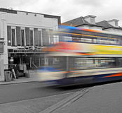 Speeding bus arrival Stock Images