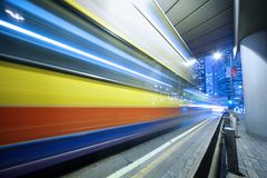 Speeding bus, blurred motion. Royalty Free Stock Photography