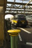 Speeding Cab. London Cab Speeding away in Railway station. blurred exposure setting Royalty Free Stock Images