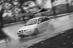 Speeding car. A car going fast with a motion blur Royalty Free Stock Image