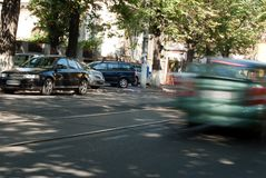 Speeding car. Speeding automotive in the middle of the day Stock Image