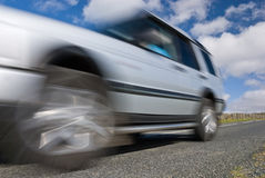 Speeding car 4x4 on mountain road. Close-up and blurred Royalty Free Stock Photography