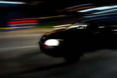 Speeding Car in the dark Stock Photography