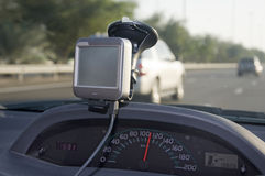 Speeding Car Dashboard. Over speeding car with dashboard and other navigational equipment and information Royalty Free Stock Photos