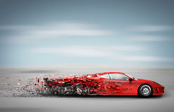 Speeding car disintegrating Stock Photography